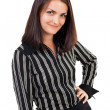 Happy young businesswoman standing with hand on hip — Stock Photo #13756219