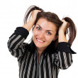 Angry businesswoman pulling her hair - Stock Photo