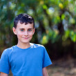 Cute boy in the woods — Stockfoto