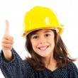 Little girl with yellow helmet showing thumbs up — Stock Photo #13757616