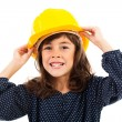 Beautiful little girl wearing construction helmet — Stock Photo