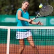 Young woman playing tennis — Stock Photo #13757703