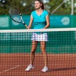 Young woman playing tennis — Stock Photo #13757705
