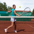 Beautiful woman tennis player prepared for backhand stroke — Stock Photo #13757719