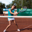 Young woman playing tennis — Stock Photo #13757721