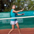 Young woman playing tennis — Stock Photo #13757724