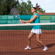 Stock Photo: Young woman playing tennis