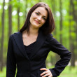 Happy businesswoman with hand on her hip — Stock Photo #13757792