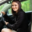 Stock Photo: Beautiful young woman with new car