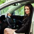 Beautiful young woman with new car — Stock Photo #13757806