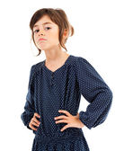 Confident little girl with hands on hips — Stock Photo