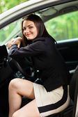 Young woman resting her head on the steering wheel — Stock Photo