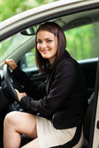 Beautiful young woman with new car — Stock Photo