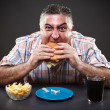 Greedy man eating burger — 图库照片