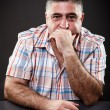 Mature man thinking while sitting at table — Stock Photo #14740203