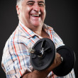 Happy fat man with dumbbell - Stockfoto