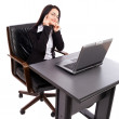 Young businesswoman sitting at desk with laptop — Foto Stock