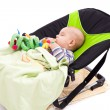 Stock Photo: Toddler sleeping in a baby lounger