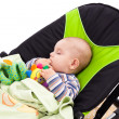Toddler sleeping in a baby lounger - Stock Photo