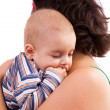 Kid sleeping in his mother&#039;s arms - 
