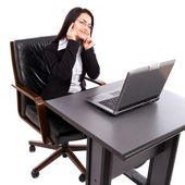 Young businesswoman sitting at desk with laptop — Photo