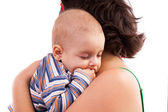 Kid sleeping in his mother's arms — Stock Photo