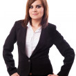 Businesswoman standing with hands on hips — Stock Photo #14981585
