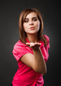 Young lady blowing kisses — Stock Photo