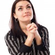 Young businesswoman praying while looking up — Stock Photo
