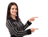 Ung affärskvinna pekar på copyspace — Stockfoto