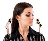 Businesswoman undecided which of her elf businesswomen advice to — Stock Photo