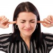 Young businesswoman with fingers in ears — Stock Photo