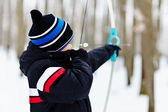 Boy shooting with the bow — Stock Photo