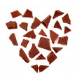 Dark chocolate in the shape of a heart - Stock Photo