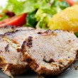 Baked tenderloin with salad - Stock Photo