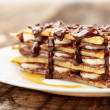 Pancakes with chocolate syrup - Stock Photo