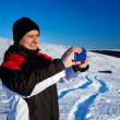 Tourist shooting the landscape with mobile phone - Stock Photo