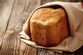 Homemade bread on a wooden board — Stock Photo