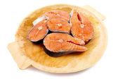 Salmon on wooden board — Stock Photo