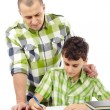 Father helping son with homework — Stock Photo #19499635
