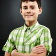 Young boy with his arms folded — Stock Photo