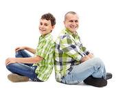 Père et fils dos à dos — Photo