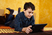 Young boy studying on digital tablet — Stock Photo