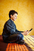 Young boy playing on tablet — Stock Photo