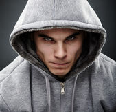 Close-up portrait of threatening thug — Stock Photo