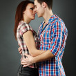 Closeup of passionate young couple embracing — Stock Photo