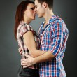 Stock Photo: Closeup of passionate young couple embracing