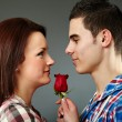 Royalty-Free Stock Photo: Young man offering a rose to the woman he loves