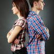 Stock Photo: Portrait of sad young couple standing back to back