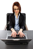 Closeup view of succesful businesswoman typing on her laptop — Stock Photo